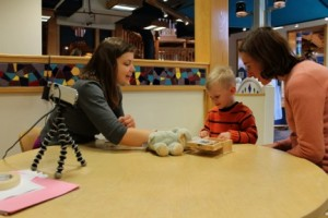 Graduate student from the Early Childhood Cognition Lab, Nadia Chernyak, conducts a study with child participant. Photo by Sciencenter.